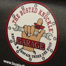 Fender Gripper® Cover, Black with Busted Knuckle Garage Logo